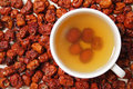 Pitted chinese jujubes with a cup of jujube tea Royalty Free Stock Image