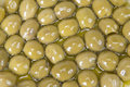 Pitted olives covered in oil Stock Photo