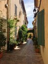 Pittoresque narrow alley with southern flair of meditterranean old fisher village Cassis in Southern France