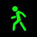 Pixel symbol pedestrian green on a black background Royalty Free Stock Images