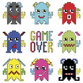 Pixelated robot emoticons with game over sign inspired by 90's computer games showing different emotions Royalty Free Stock Photo