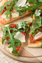 Pizza with arugula rucola tomatoes and parmesan Stock Image