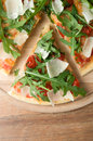 Pizza with arugula rucola tomatoes and parmesan Stock Photography