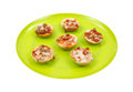 Pizza on bagels side view cooked plate a group of small topped with a green Royalty Free Stock Photo