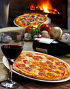 Pizza baked in wood oven Royalty Free Stock Photography