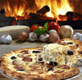 Pizza baked in wood oven Royalty Free Stock Images