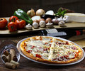 Pizza baked in wood oven Stock Image