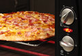 Pizza being cooked  in oven Royalty Free Stock Image