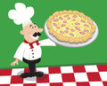 Pizza chef standing on checkered floor presenting large Stock Images