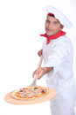 Pizza chef with a wooden peel Royalty Free Stock Image