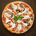 Pizza with chicken, tomato and mushrooms top view Royalty Free Stock Photo