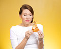 Pizza cravings closeup portrait conflicted young woman holding desiring fatty not sure if she should eat because extra calories Stock Photos