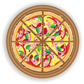 Pizza cut on a wooden board Royalty Free Stock Photo