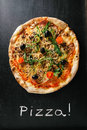 Pizza delicious on black surface Royalty Free Stock Photo