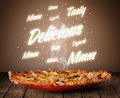 Pizza with delicious and tasty glowing writings on wood deck Royalty Free Stock Image