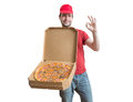 Pizza delivery concept. Young man is carrying boxes with tasty pizza. Royalty Free Stock Photo