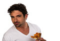 Pizza delivery man with a pizza chef or cook fresh from the oven Stock Image