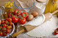 Pizza dough and ingredients with tomatoes olive oil Royalty Free Stock Images