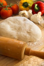 Pizza dough and rolling pin Royalty Free Stock Images