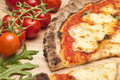 Pizza food cheese fresh out of the oven with tomatoes and rocket Royalty Free Stock Image