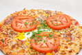 Pizza with fresh tomato and egg Stock Photography