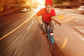 Pizza guy traveling on his moped Stock Photography