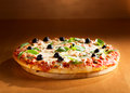 Pizza with ham and olives Royalty Free Stock Photo