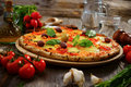 Pizza homemade fresh with mozarela cherry tomatoes and basil Royalty Free Stock Photo