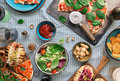 Pizza, hot dogs, wine, beer and a snack for beer Royalty Free Stock Photo