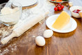 Pizza ingredients, eggs and cheese on wooden tabletop