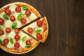 Pizza margherita on dark wooden background top view with space for text Stock Photo
