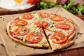 Pizza margherita made with tomatoes gauda cheese and mozzarella Stock Photo