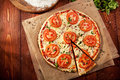 Pizza margherita made with tomatoes gauda cheese and mozzarella Stock Images