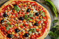 Pizza with minced meat tomato cheese corn olives Royalty Free Stock Photo