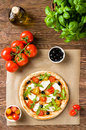 Pizza with mozzarella and arugula uncooked top view Royalty Free Stock Images