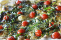 Pizza mozzarella with cherry tomatoes and fresh herbs Royalty Free Stock Photos
