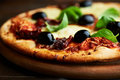 Pizza with Mozzarella and Dried Tomatoes Royalty Free Stock Photos