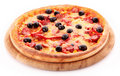 Pizza with olives on wooden plate isolated Royalty Free Stock Photography