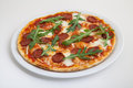 Pizza with salami, cheese and arugula Royalty Free Stock Photo