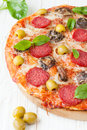Pizza with salami and sliced mushrooms mozzarella fast food Stock Images
