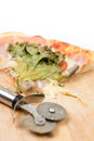 Pizza slice with lettuce and tomato and copy space over white background Royalty Free Stock Photo