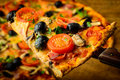 Pizza slice traditional baked homemade italian closeup detail Royalty Free Stock Photo