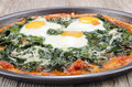 Pizza with spinach and fried egg Royalty Free Stock Images