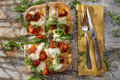 Pizza with tomato and arugula tricolor mozzarella fresh Royalty Free Stock Image