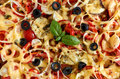 Pizza with tomatoes, bell pepper, onion, black olives, cheese and basil texture background. Pizza texture surface. Pizza texture Royalty Free Stock Photo