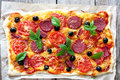 Pizza with tomatoes, cheese and salami Royalty Free Stock Photo