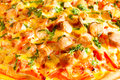 Pizza with tomatoes and wurstel detail of potatoes Stock Photo