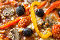 Pizza topping background with olives and vegetables Royalty Free Stock Image