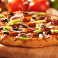 Pizza with toppings close up photo of a and shot selective focus Stock Photography