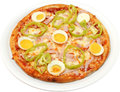 Pizza toscana with cheese bacon egg and ham isolated Royalty Free Stock Images